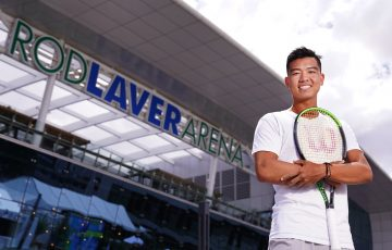READY TO SHINE: Li Tu outside Rod Laver Arena. Picture: Tennis Australia