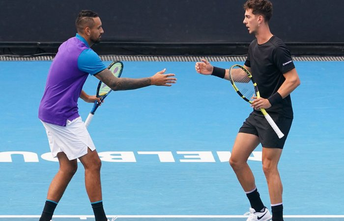 Nick Kyrgios and Thanasi Kokkinakis during an Australian Open 2021 doubles match. Picture: Tennis Australia