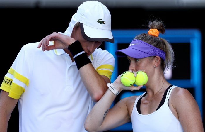 Marc Polmans and Storm Sanders talk tactics during a mixed doubles match at Australian Open 2021. Picture: Tennis Australia