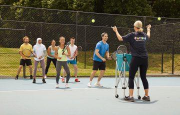 Participants enjoy a Cardio Tennis session.