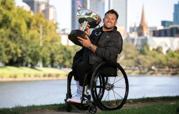 Dylan Alcott celebrates his seventh Australian Open quad wheelchair singles title.