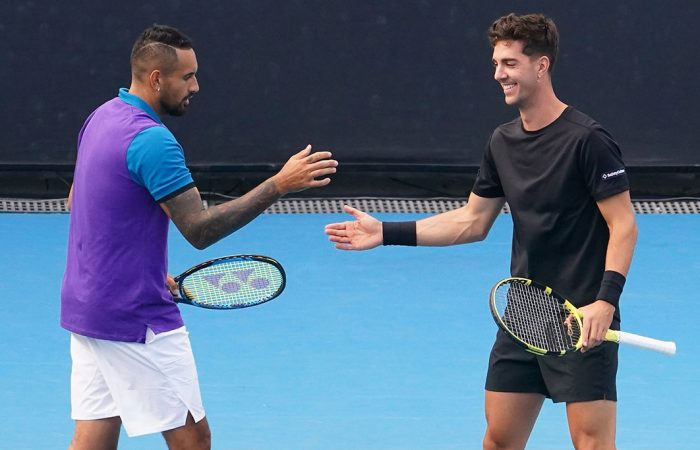 Thanasi KOKKINAKIS (AUS) and Nick KYRGIOS (AUS) celebrate a point as they play Lloyd HARRIS (RSA) and Julian KNOWLE (AUT) in the Mens Doubles on Court 3 during Day 6 of the Australian Open at Melbourne Park on Saturday, February 13, 2021. MANDATORY PHOTO CREDIT Tennis Australia/ SCOTT BARBOUR