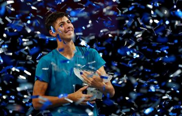 Alexei Popyrin lifts his maiden ATP trophy at the Singapore Tennis Open; Getty Images