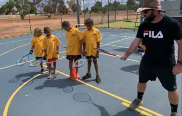 Jarron Kretschmann delivers tennis programs to children in remote Australian communities.