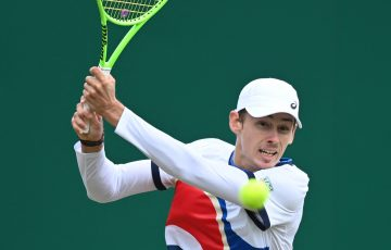 Alex de Minaur returns during his semifinal win at Eastbourne. Picture: Getty Images