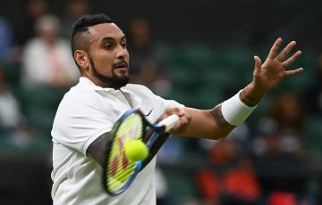 Australia's Nick Kyrgios fires a forehand during his first-round match at Wimbledon 2021. Picture: Getty Images