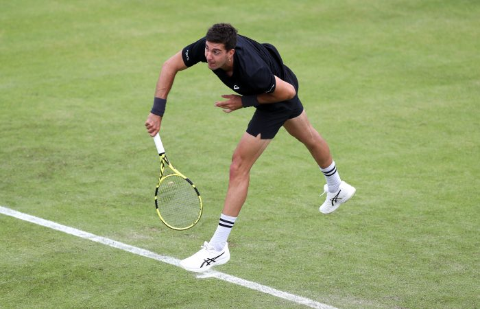Thanasi Kokkinakis serves during his first-round match at Nottingham. Picture: Getty Images