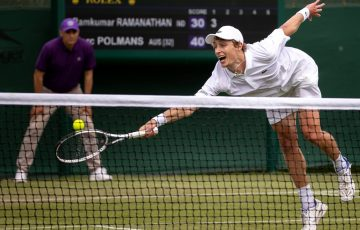 Australia's Marc Polmans stretches for a volley during Wimbledon qualifying action. Picture: AELTC