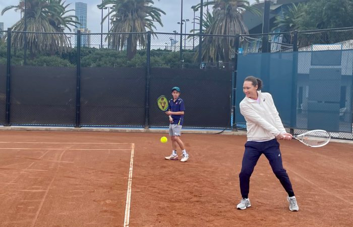 Sam Stosur hits with juniors. on the clay courts at Melbourne's National Tennis Centre