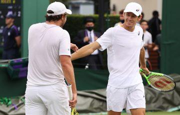 Matt Reid and Alex de Minaur during their first-round win at Wimbledon 2021. Picture: Getty Images