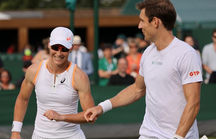 Sam Stosur and Matt Ebden are all smiles in mixed doubles action at Wimbledon. Picture: Getty Images