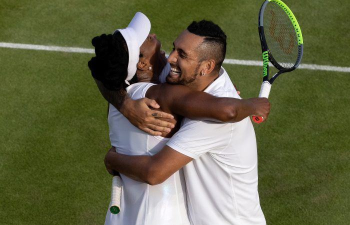 Venus Williams and Nick Kyrgios embrace after scoring a first-round mixed doubles win at Wimbledon. Picture: Getty Images