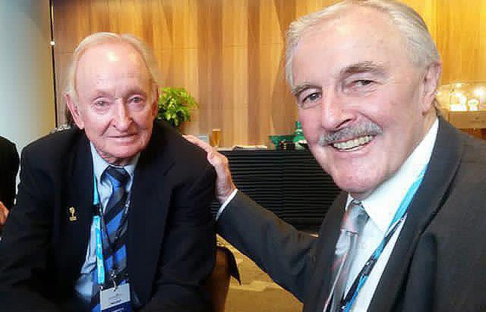 Wayne Reid (right) with Rod Laver.