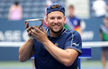 Dylan Alcott of Australia celebrates with the US Open trophy; Getty Images