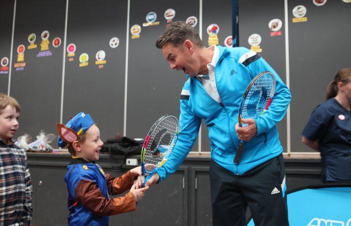 Todd Woodbridge presents a racquet as part of the ANZ Tennis Hot Shots Racquet Roadshow. Picture: Tennis Australia