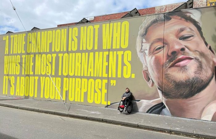 Dylan Alcott in front of his Melbourne mural. Picture: Instagram